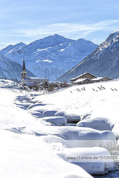 Torrent with church in winter snow  Livigno  Valtellina  Lombardy  Italy  Europe