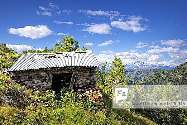 Old hut with Rhaetian Alps in the background  Valgerola  Orobie Alps  Valtellina  Lombardy  Italy  Europe