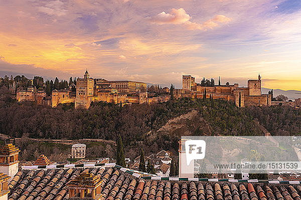 View of the Alhambra  UNESCO World Heritage Site  with the Sierra Nevada mountains in the background  at sunset  Granada  Andalucia  Spain  Europe