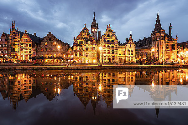 Graslei in the historic city of Ghent reflected in Leie river during blue hour  Ghent  East Flanders  Belgium  Europe