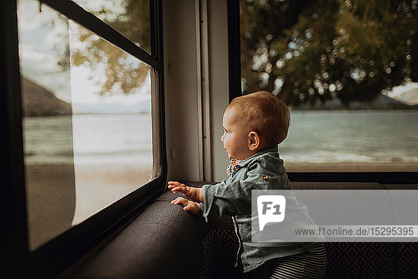 Baby looking out window of motorhome  Wanaka  Taranaki  New Zealand