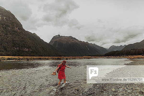 Woman exploring lake  Queenstown  Canterbury  New Zealand