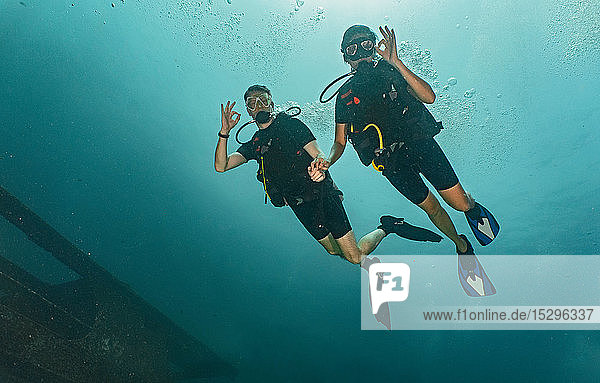 Couple divers showing ok sign  Ko Racha Yai  Rawai  Phuket  Thailand