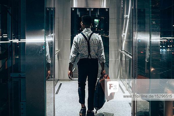 Businessman entering elevator