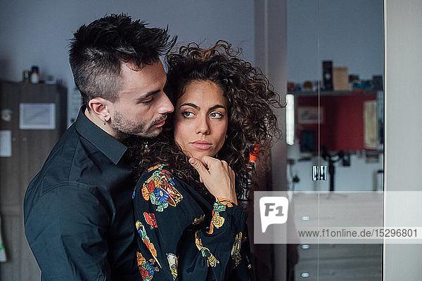 Couple hugging in room