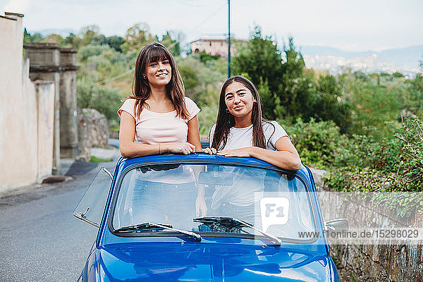 Friends posing in car sunroof  Florence  Toscana  Italy
