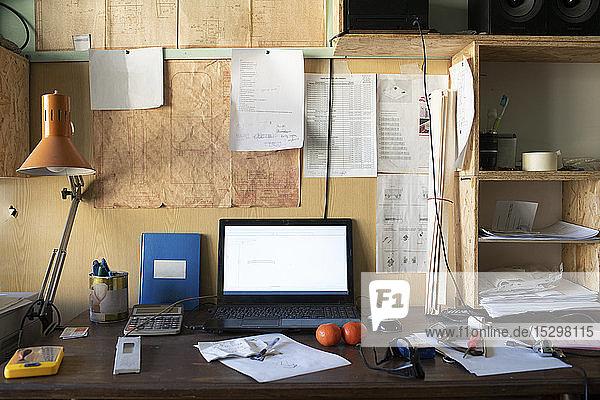 Carpentry workshop  desk with laptop