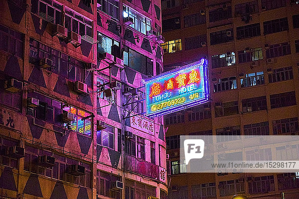 Lighted neon sign of a hotel at night  Kowloon  Hong Kong  China