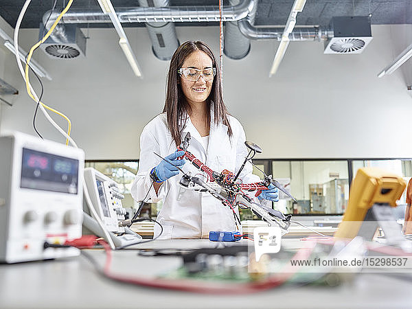 Female technician working in research laboratory  developing drone