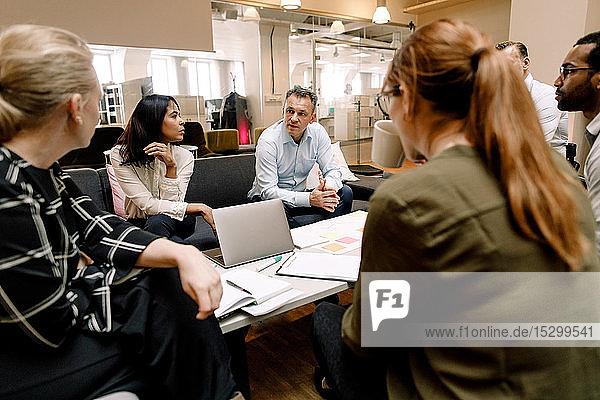 Serious sales executives having meeting at work place