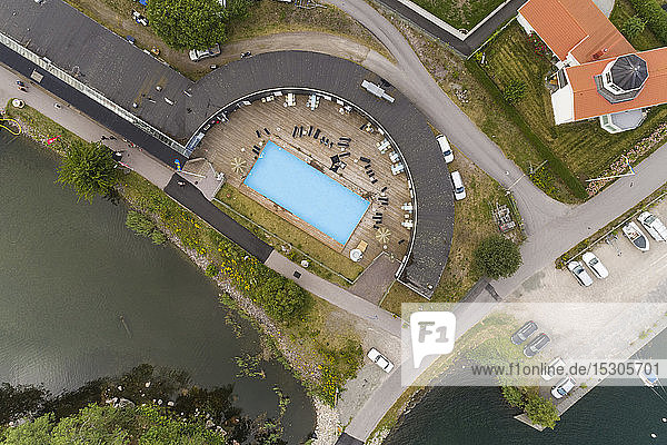 Arial view of a part of harbor in Vaestervik in summer with a swimming pool of a resort  Sweden