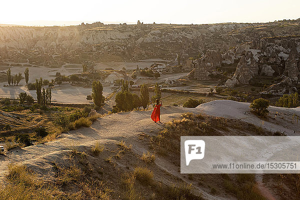 Woman standing in rocky landscape at dusk  Goreme  Cappadocia  Turkey
