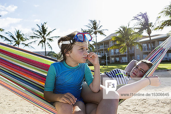 5 year old boy in hammock with his 13 year old sister