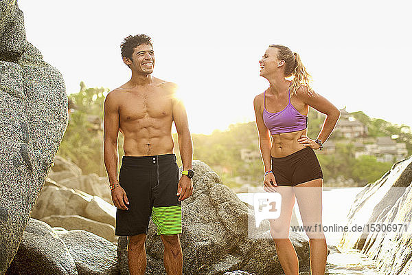 Young  fit couple laughing on beach  Sayulita  Nayarit  Mexico