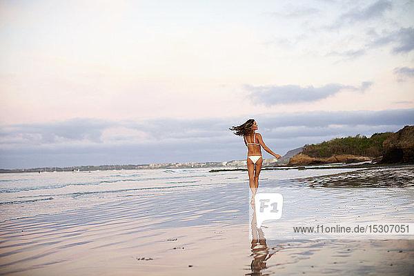 Carefree woman in bikini running on beach  Sayulita  Nayarit  Mexico