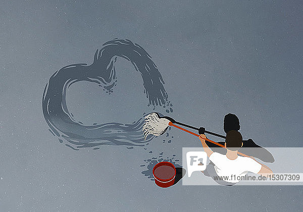 Man drawing heart-shape with mop