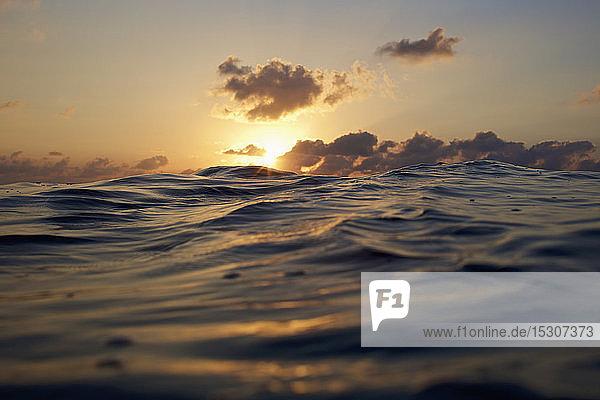 Sunset over tranquil ocean