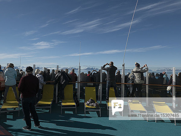 Tourists on cruise ship looking at scenic view  Island of the Svalbard Archipelago  Northern Norway