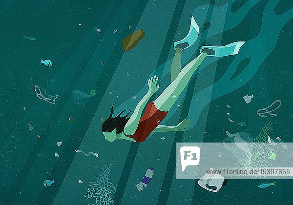 Frau schwimmt unter Wasser im Meer inmitten der Verschmutzung