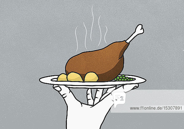Hand holding tray with steaming chicken leg  potatoes and peas