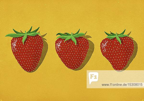 Rote Erdbeeren auf leuchtend gelbem Hintergrund