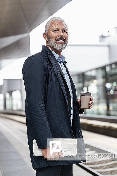 Mature businessman at the station platform