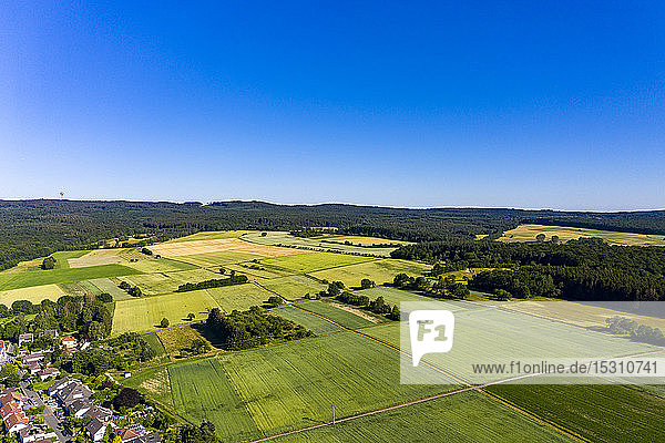 Aerial view over grain fields  meadows  woods and villages  Wetterau  Germany