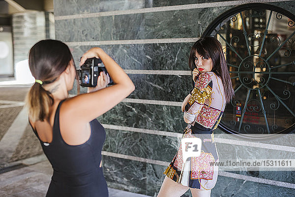Young woman wearing patterned dress posing for a photo shoot
