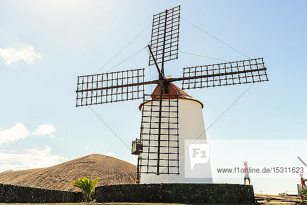 Man next to old windmill  Lanzarote  Canary Islands  Spain