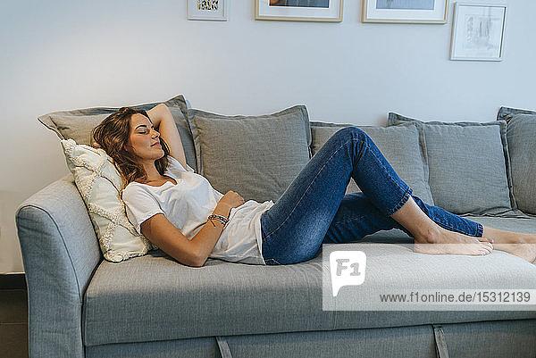 Young woman sleeping on the living room sofa
