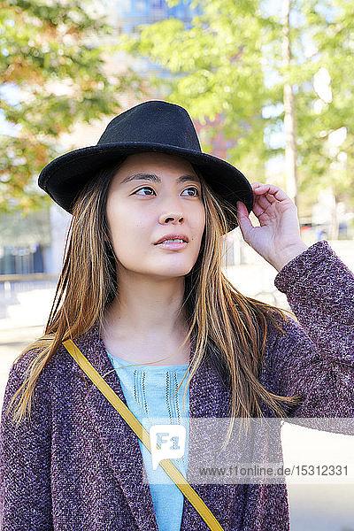 Portrait of woman wearing a hat  Barcelona  Spain
