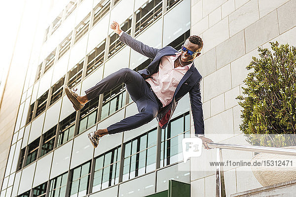 Young businessman jumping mid-air