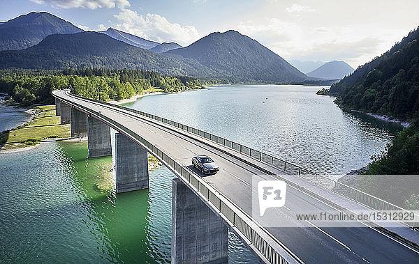Aerial view of a car crossing a bridge  Sylvenstein Dam  Bavaria  Germany