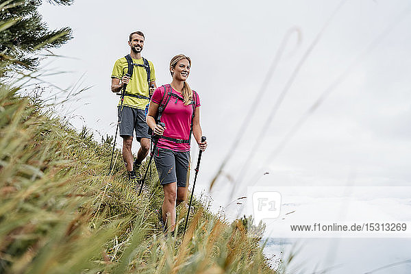 Confident young couple on a hiking trip in the mountains  Herzogstand  Bavaria  Germany