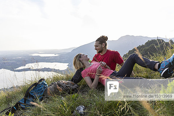 Hiking couple taking a break  lying in mountain meadow