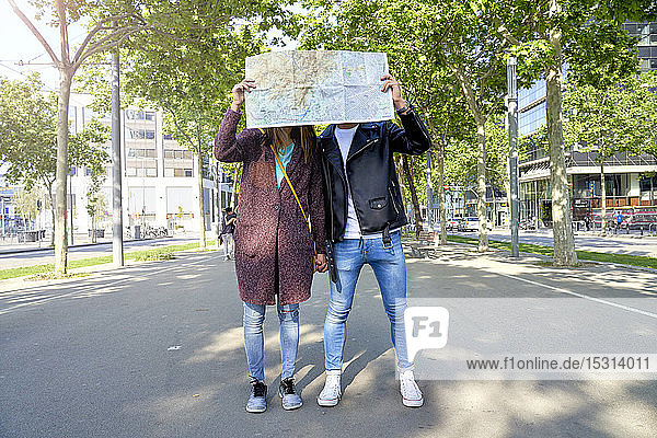 Couple looking at city map in Barcelona  Spain