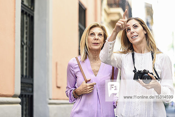 Mature woman traveling together with her daughter in the city