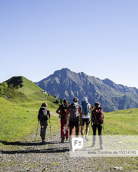 Group of hikers walking in the mountains  Orobie Mountains  Lecco  Italy