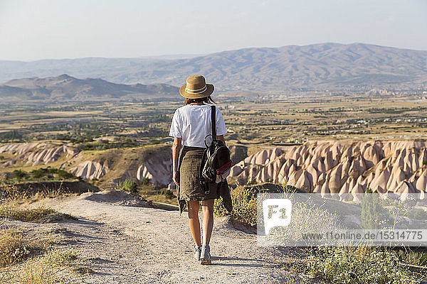 Woman walking to viewpoint near Uchisar  Cappadocia  Turkey