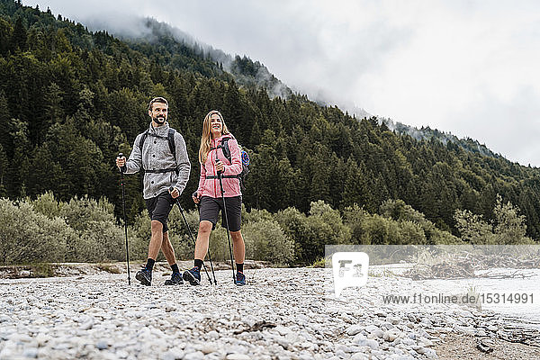Young couple on a hiking trip at riverside  Vorderriss  Bavaria  Germany