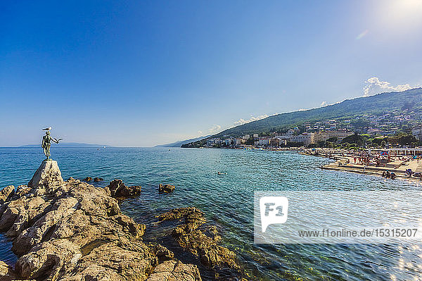 Opatija town at coast of Adriatic Sea against blue sky during sunny day