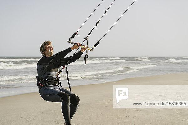 Kiteboarder preparing his kite