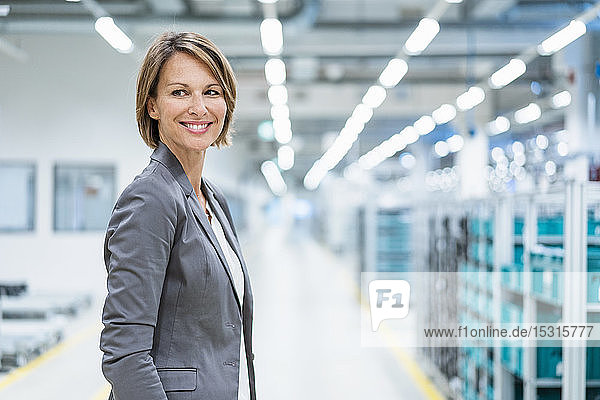Portrait of a smiling businesswoman in a modern factory