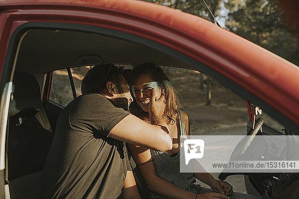 Couple on a road trip  taking a break