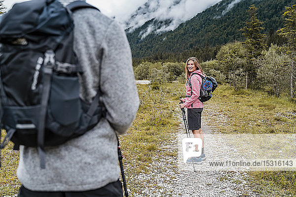 Young couple on a hiking trip  Vorderriss  Bavaria  Germany