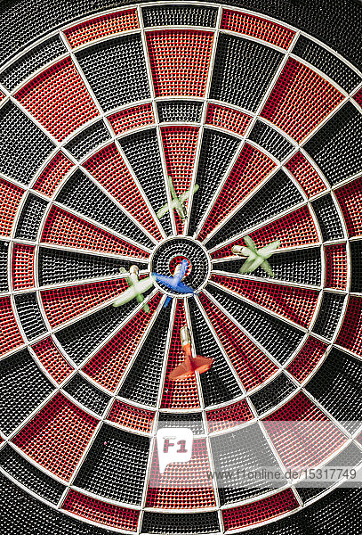 Close-up of darts in electronic dartboard
