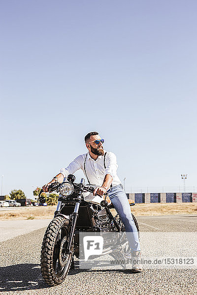 Portrait of bearded man sitting on his motorbike