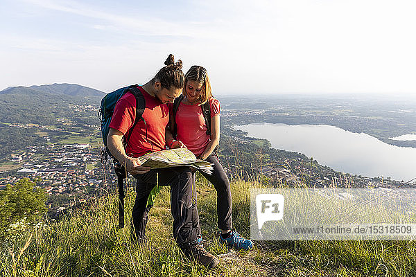 hiking couple looking on map