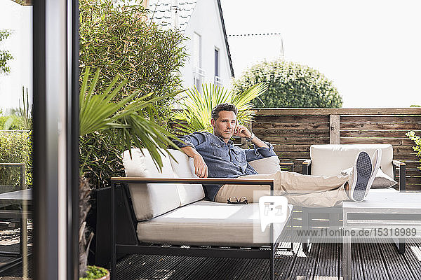 Confident man relaxing on the terrace