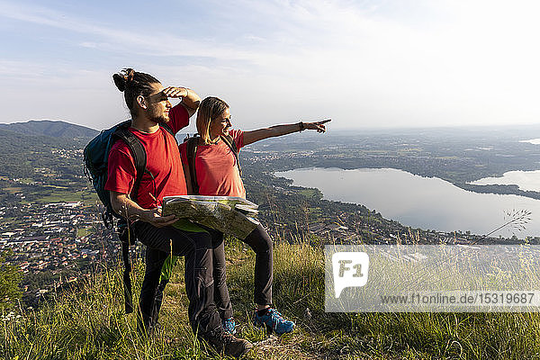 Young couple in the mountains  looking at view